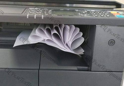 МФУ Kyocera заминает бумагу
